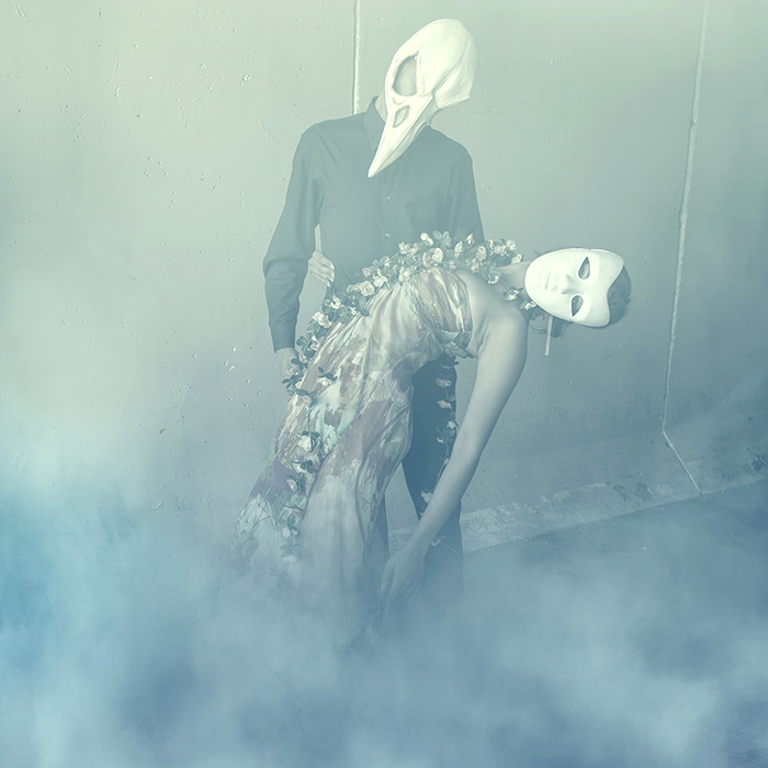 Manipulated photo o man with bird mask dancing with woman in mask by tracy whiteside