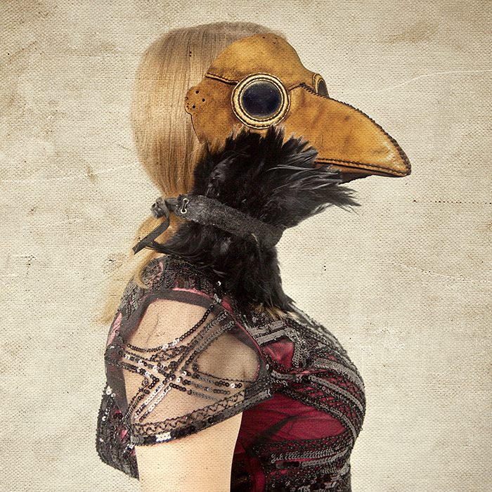 Manipulated photo of a girl hybrid with plague doctor mask